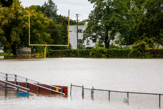 A goal post sticks up from flood waters Wednesday, Oct. 2, 2019, at Fruth Field in Fond du Lac, Wis. Several inches of rain fell over the area causing widespread flooding issues.