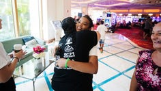 Patricia Amandis, left,  a DJ from Naples embraces Abacos, Bahamas resident Selena Suanders,16, on September 22, 2019, at the Baha Mar resort in Nassau. Amandis gathered supplies and goods from Naples to donate to families affected by Hurricane Dorian. Saunders survived the storm on Abaco Island