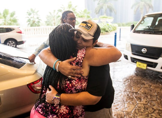 Patricia Amandis, a DJ from Naples embraces Nassau, Bahamas resident Mia Campbell on September 22, 2019, at the Baha Mar resort in Nassau. Amandis gathered supplies and goods from Naples to donate to Campbell and families affected by Hurricane Dorian. Campbell was affected by flooding. She plans on getting some of the supplies Abaco residents affected by the storm.