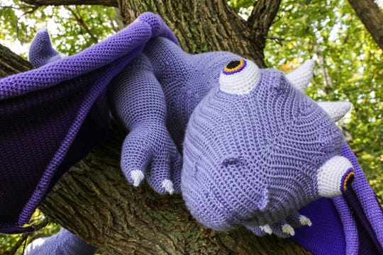 Dierdra Stary, a University of Wisconsin-Green Bay alumna, made the huge purple dragon in pieces and then assembled it.