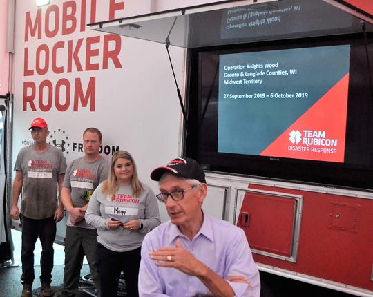 Gov. Tony Evers speaks to a group volunteers from Team Rubicon and Americorps in the town of Riverview on Tuesday afternoon. The volunteers are spending 10 days in Oconto and Langlade counties removing trees and brush downed by the major storm in July.