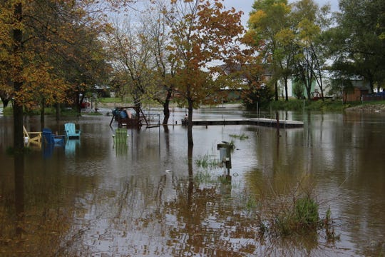 The Suamico River floods a backyard on Wednesday, Oct. 2, 2019, along Riverside Drive in Suamico.