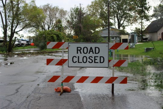 Longtail Beach Lane is closed at Longtail Beach Road on Wednesday, Oct. 2, 2019, in Suamico. Heavy rains Tuesday and Wednesday led to high water along the bay.