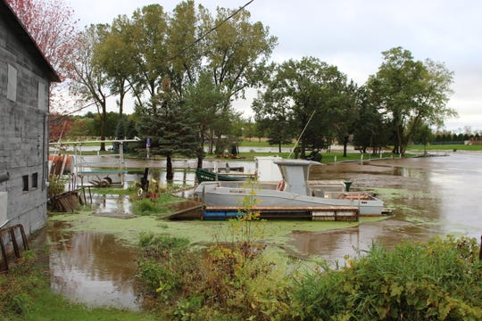 The Suamico River floods on Wednesday, Oct. 2, 2019, along Riverside Drive in Suamico.