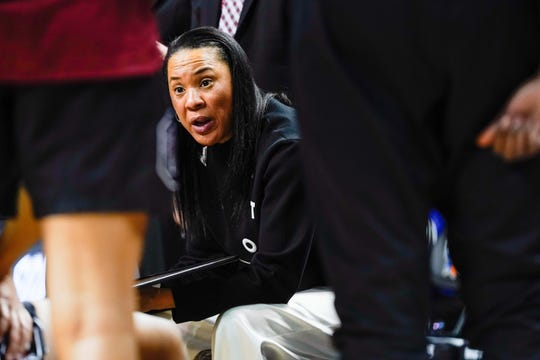 Mar 30, 2019; Greensboro, NC, USA; South Carolina Gamecocks head coach Dawn Staley talks to her players in the huddle during the second half against the Baylor Lady Bears in the semifinals of the Greensboro regional in the women's 2019 NCAA Tournament at Greensboro Coliseum. Mandatory Credit: Jim Dedmon-USA TODAY Sports