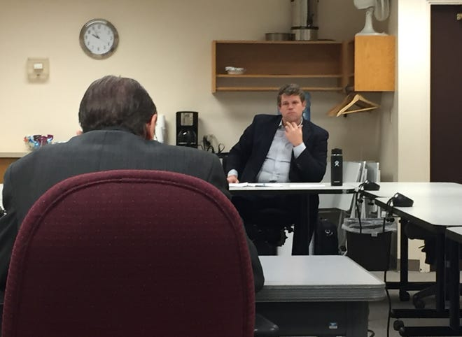 Brad Jones, counsel for the Montana Board of Dentistry, right, listens Wednesday as Dr. John Bennion testifies.