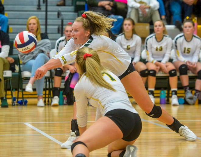 C.M. Russell's Allie Olsen makes a dig during last month's crosstown match with Great Falls High. The Rustlers beat Butte in their first round match Thursday at the State Volleyball Tournament at Bozeman's Brick Breeden Fieldhouse.