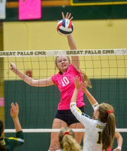 Great Falls High's Taylor VanderMars spikes at the net during a match earlier this season.