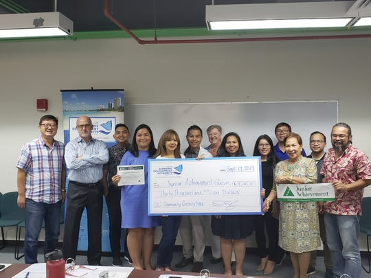 "The Guam Economic Development Authority board presented Junior Achievement Guam with $30,000 Sept. 19 at the ITC Building in Tamuning. From left: George Chiu, GEDA director; David John, GEDA chairman of the board; Artemio ""Ricky"" Hernandez, GEDA deputy administrator; Melanie Mendiola, GEDA CEO/administrator; Beth Lizama, JA Guam executive director; Ernesto Espaldon, Jr., GEDA vice chairman of the board; Meg Tyquiengco, JA Guam Chairman; Siska Hutapea, GEDA director; Erlinda D. Alegre, JA Guam board member; Joey Miranda, III, JA Guam board member; Fe Valencia-Ovalles, GEDA director; Andrew Perez, JA Guam board member;  and Deepak Dewan, GEDA director."