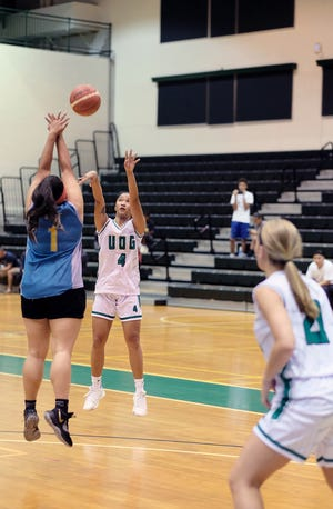 The Lady Tritons' Jan-Nasia Tavilla goes for a 3-pointer against Fuetsa Basketball Monday in the PBS Guam Women's Basketball League at the UOG Calvo Field House.
