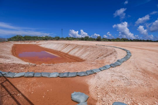 A ponding basin is seen close to the edge of an open field of compacted base coral, near the Guam Waterworks Authority's Northern District Wastewater Treatment Plant, in Harmon on Wednesday, Oct. 2, 2019. A resident told the Public Utilities Commission the island's new power plant should be built next to the wastewater plant instead of next to the Harmon substation, which is near homes, the mall and the hospital.
