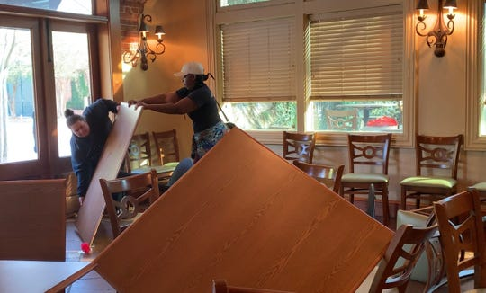 On Tuesday, friends help Vikki Terrell clean up her downtown Hattiesburg restaurant, Vikki Layne's Bar and Grill, which was vandalized Sunday or Monday, Sept. 29-30, 2019.