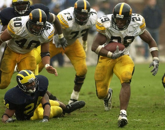Jermelle Lewis (29) had the game of his lifetime, logging two second-half touchdowns that put the game away in Iowa's 34-9 win at Michigan in 2002.