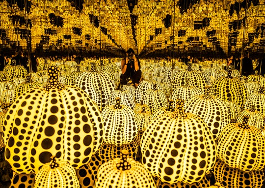 """IndyStar multimedia journalist Michelle Pemberton photographs the new """"Infinitely Kusama"""" exhibition, showcasing Yayoi Kusama's famous Infinity Mirror Room, """"All the Eternal Love I Have for the Pumpkins,"""" (2016), at the Indianapolis Museum of Art, on the Newfields campus, Tuesday, Oct. 1, 2019."""