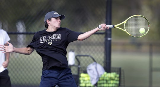 Mt. Vernon high school tennis player Chris Hays during a recent practice.  The team now practices on the tennis courts at Hamilton Southeastern Intermediate School, and conditions on a football field.
