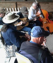 Nearly 200 instrument-toting lovers of old time music from a wide area descended on the Johnson County Fairgrounds Sunday to spend a rainy afternoon jamming and performing their favorites.