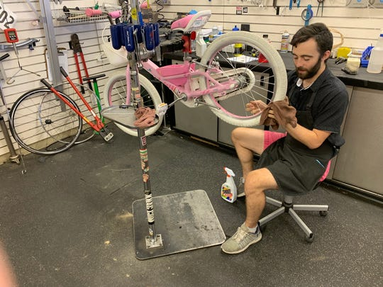 Andrew Kraninger refurbishes a bicycle at Indian Cycle & Fitness in Ridgeland.