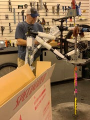 Clint Jenkins puts together a bicycle at Indian Cycle & Fitness in Ridgeland.