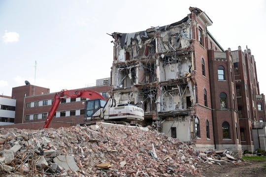 Demotion continues on the Old St. Elizabeth's building on N. 14th Street, Tuesday, Oct. 1, 2019, in Lafayette.