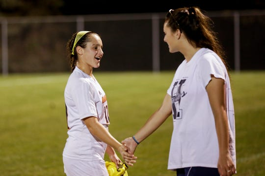 Harrison assistant coach Olivia Geswein and Harrison's Lexi Fraley (11) share a moment after Fraley passed Geswein's school record for most goals a season, Tuesday, Oct. 1, 2019 in West Lafayette. Fraley scored five goals during Tuesday's game against West Lafayette, to total 32 goals this season, Geswein's record was 30.