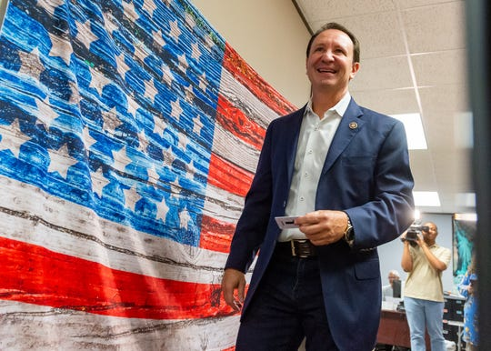 Louisiana Attorney General Jeff Landry arrives Wednesday, Oct. 2, 2019, at the Registrar of Voters office in Lafayette for early voting in the primary election.