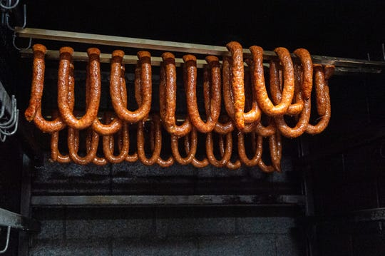Smoked Sausage hanging in the smoker at Johnsons Boucaniere. Tuesday, Oct. 1, 2019.
