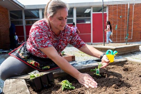 James A. Herod Elementary fifth-grade teacher Hannah Hebert and her students work in the Abbeville school's garden Wednesday, Oct. 2, 2019.