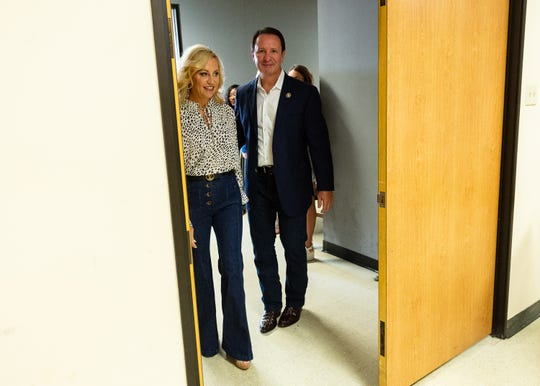 Louisiana Attorney General Jeff Landry and his wife, Sharon, arrive Wednesday, Oct. 2, 2019, at the Registrar of Voters office in Lafayette for early voting in the primary election.