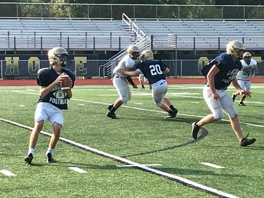 Lancaster senior running back Max Hamilton prepares to throw a pass during Tuesday's practice at Fulton Field.