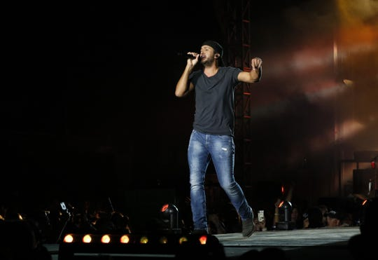 Country music star Luke Bryan performs Saturday night, Sept. 28, 2019, at the Miller family farm near Pleasantville. Bryan, Cole Swindell, The Peach Pickers and Mitchell Tenpenny performed as part of Bryan's Farm Tour 2019. More than 20,000 people attended the concert which was held in a field in rural Fairfield County. Officials report only one arrest and no major problems from the event.