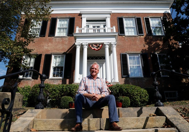 David Hogrefe, the executive director of the Decorative Arts Center of Ohio, sits in front of the museum Wednesday, Oct. 2, 2019, in downtown Lancaster.