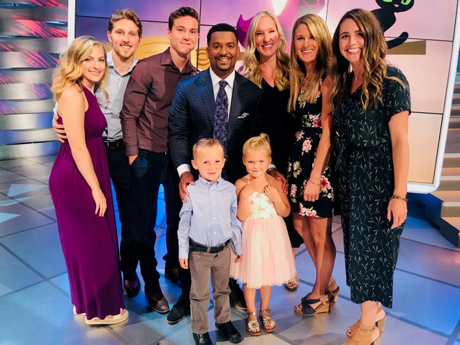 Preschoolers Major Sylvester and Maci McCoy (front) stand on the America's Funniest Home Videos stage with host Alfonso Ribeiro (center) and (from left) Maddie Gross, Brent Walter, Evan Walter, Kara Walter, Jackie McCoy and Jackie Sylvester, at an episode taping in September 2019.