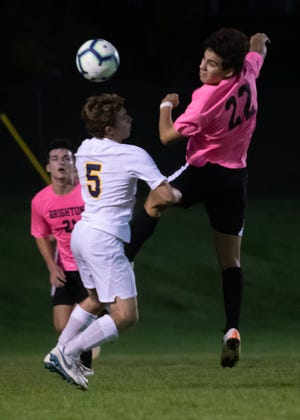 Brighton's Aiden Brown (22) and Hartland's Ben Gietek (5) battle for the ball in a soccer game on Tuesday, Oct. 1, 2019.