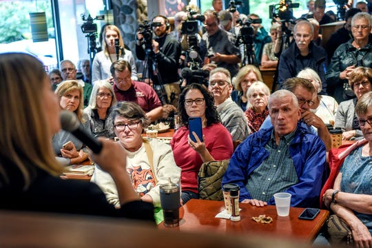 Participants listen as U.S. Rep. Elissa Slotkin, D-Holly, speaks during her Ingham County Coffee Hour event on Wednesday, Oct. 2, 2019, at the Grand Traverse Pie Company in East Lansing.