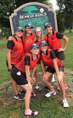 Nancy Noble's Ashland Arrows celebrate their fifth straight Division I sectional golf title Wednesday
