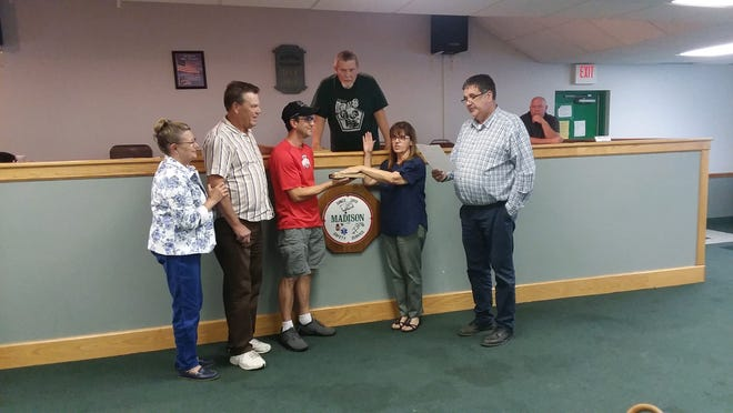 Leanna Rhodes was sworn in as the new fiscal officer for Madison Township Monday. From left,former fiscal officer Sharon Willcox, trustees chairman Dan Fletcher, Rhodes' son Jeremy Rhodes holding the Bible, Leanna Rhodes and trustee Tom Craft; and back, trustee Jim Houser and Fire Chief Ron Luttrell.