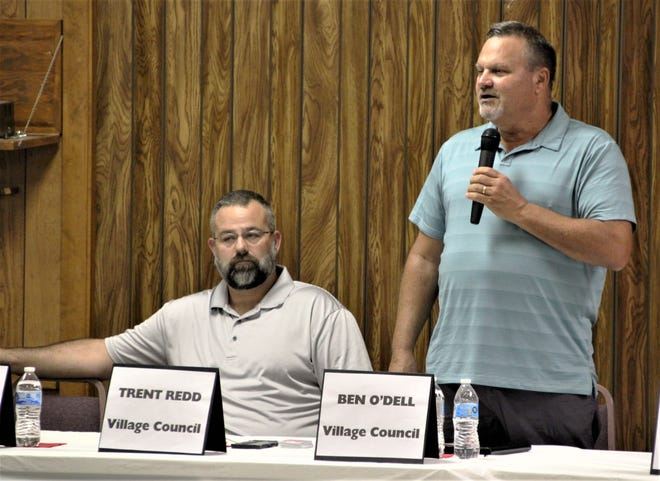 Benjamin O'Dell, right, one of the six candidates running for Prospect Village Council, addresses the audience during a candidate forum held Tuesday evening. Fellow candidate Trent Redd, left, listens as O'Dell speaks. Two seats on village council are being contested in the Nov. 5 general election.