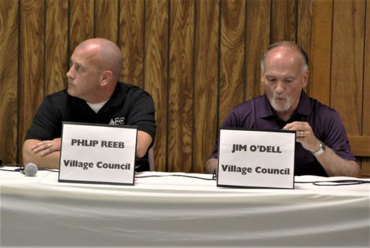 Prospect Village Council candidates Phillip Reeb, left, and Jim O'Dell wait for their chance to answer questions during the candidate forum on Tuesday.