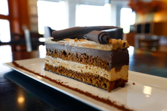 Pastry Chef Franck Oysel's dark chocolate ganache, coffee butter cream and sponge cake dessert called the Opera at Interim Restaurant Wednesday, Oct. 2, 2019.