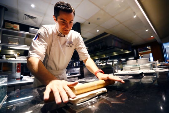 Pastry Chef Franck Oysel rolls dough for his desserts in the kitchen at Interim Restaurant Wednesday, Oct. 2, 2019.