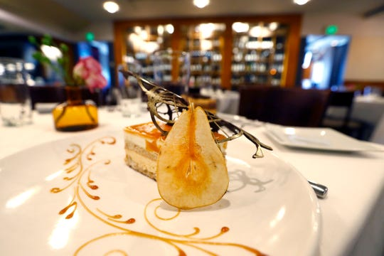 Pastry Chef Franck Oysel's pear cake with caramel and cinnamon flavored sponge cake and moose, a dessert called the Fall, at Interim Restaurant Wednesday, Oct. 2, 2019.