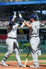 Yasmani Grandal, left, and Mike Moustakas were key parts of the Brewers offense, but both will be looking for the long-term contracts. Moustakas has done back-to-back one-year deals.