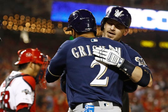Trent Grisham celebrates with former Brewers catcher Yasmani Grandal after a two-run homer by Grandal last season.