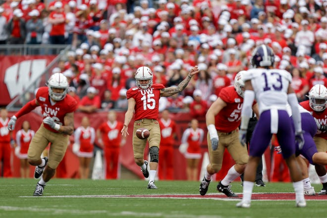 Anthony Lotti punts during the second half Saturday against Northwestern.