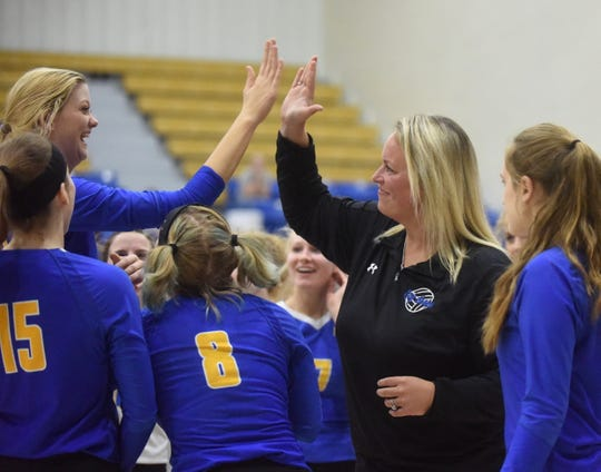 Mountain Home head coach Jill Daves gives Reanna Dodge a high-five during the Lady Bombers' win over Greene County Tech.