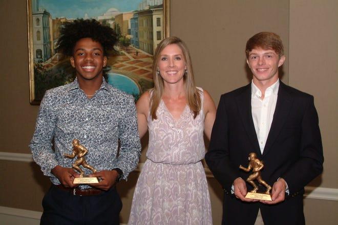 From left, Prattville High School's Albert Taggart, III, Montgomery Quarterback Club speaker Lauren Sisler from ESPN, and Lowndes Academy's Trevor Haney.