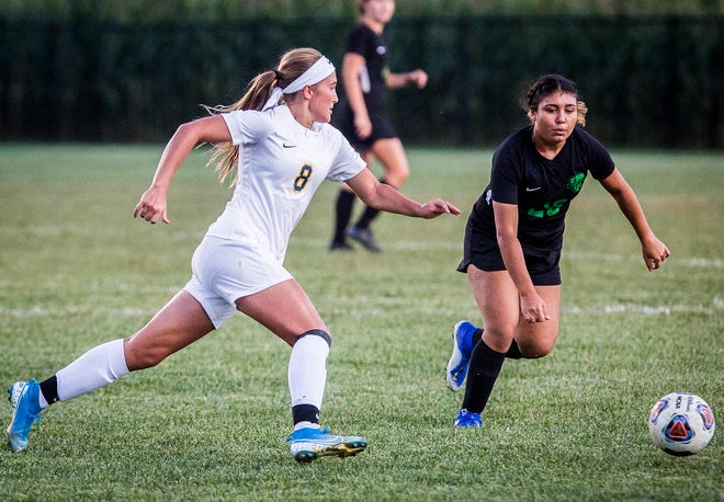 FILE -- Delta's Addie Chester works past a Yorktown defender during their sectional game at the Yorktown Sports Park Tuesday, Oct. 1, 2019. On Monday, Chester committed to play soccer at Louisville.