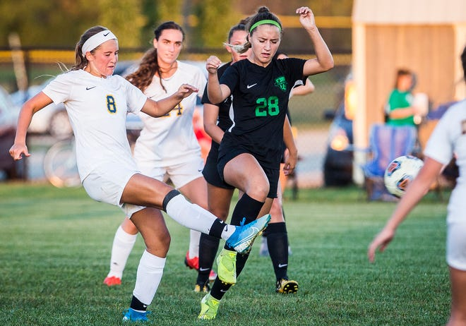 Yorktown's Chloe Mariotti (28) guards Delta's Addie Chester (8) during their game at the Yorktown Sports Park Tuesday, Oct. 1, 2019.