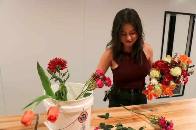 Lauren Bourgeois makes an arrangement in her new shop, Merrystem, on Oct. 1, 2019.