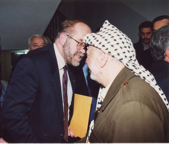 Ron Schlicher, former Consul-General with the U.S. State Department, speaks with former Palestinian political leader Yasser Arafat in an undated photo. Schlicher, who moved to Brentwood after his retirement in 2011, died unexpectedly last month.